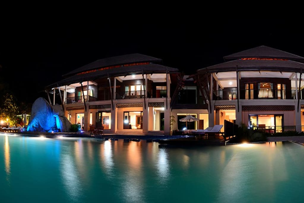 2 of the 5 buildings at nightime,have 3 bedrooms first floor,2 lounges ground floor,2 spa suite bedrooms lower floor plus spa villa and spa and gym