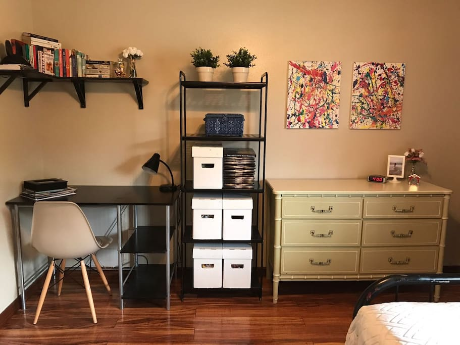 The room also has counter space and a desk.