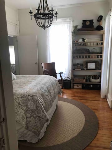 Updated master bedroom with chandelier and cabinet in August 2019