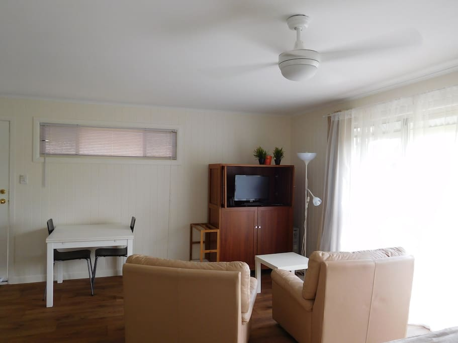 Comfortable living spaces with leather armchairs, TV with DVD, lots of study space, dining space and storage