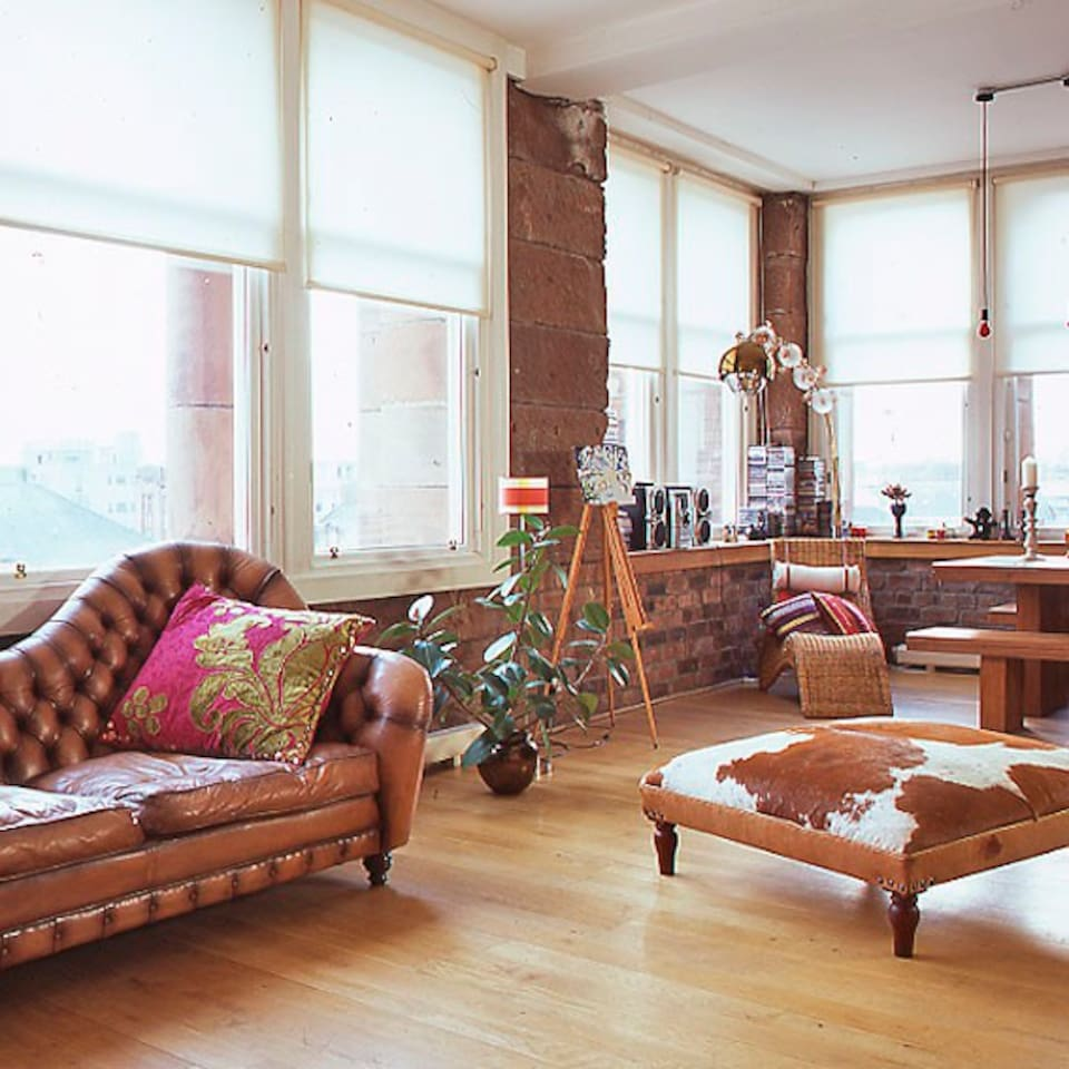 The Main Living Area in The Loft  40 ft old classroom with 13 large sash windows with panoramic views overlooking Glasgow