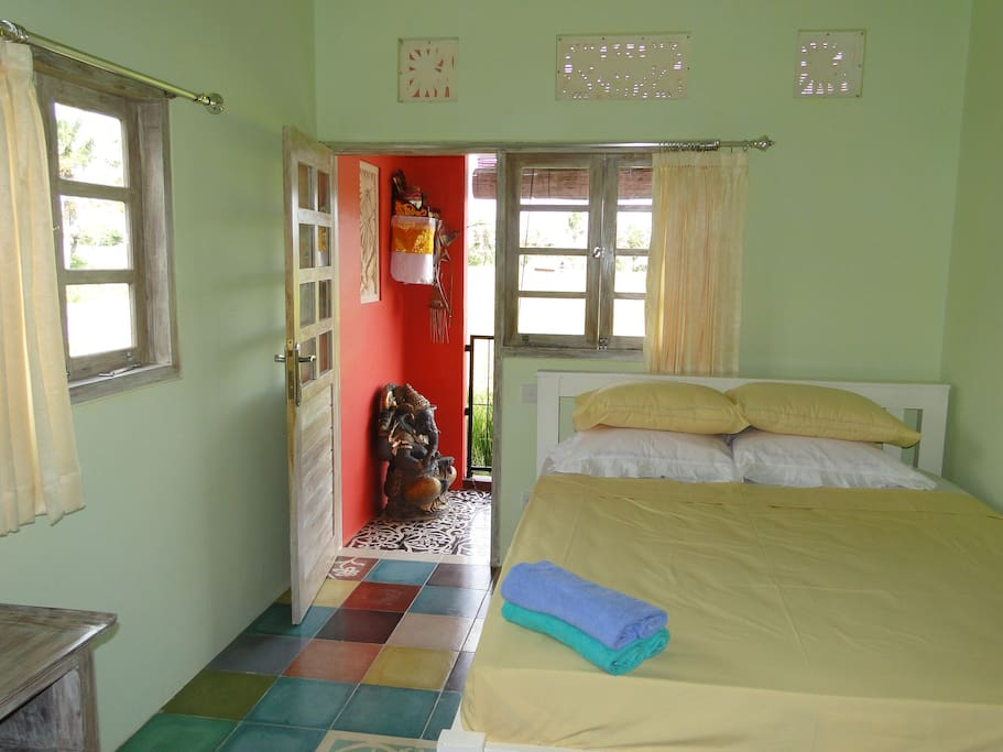 Double room - for one or two persons (same price) - guarded by ganesha - comfortable mattress, ensuite bathroom with own hot water, fan, plenty of light, lockable cabinet