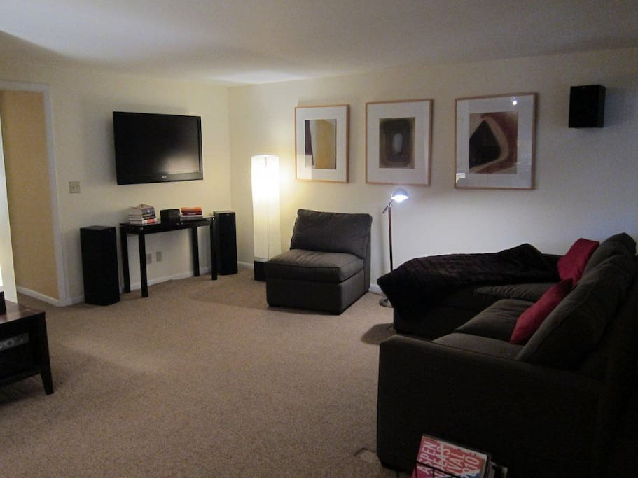 Confortable Couches in spacious living room with large SONY flat screen HDTV and surround sound
