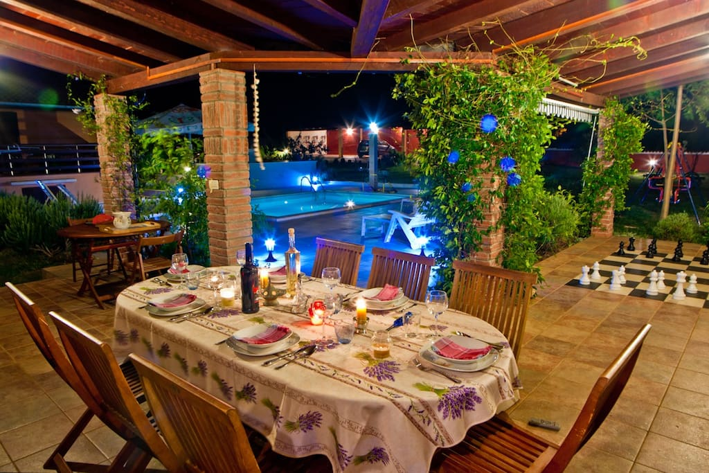 Romantic dinning by the pool in the night time