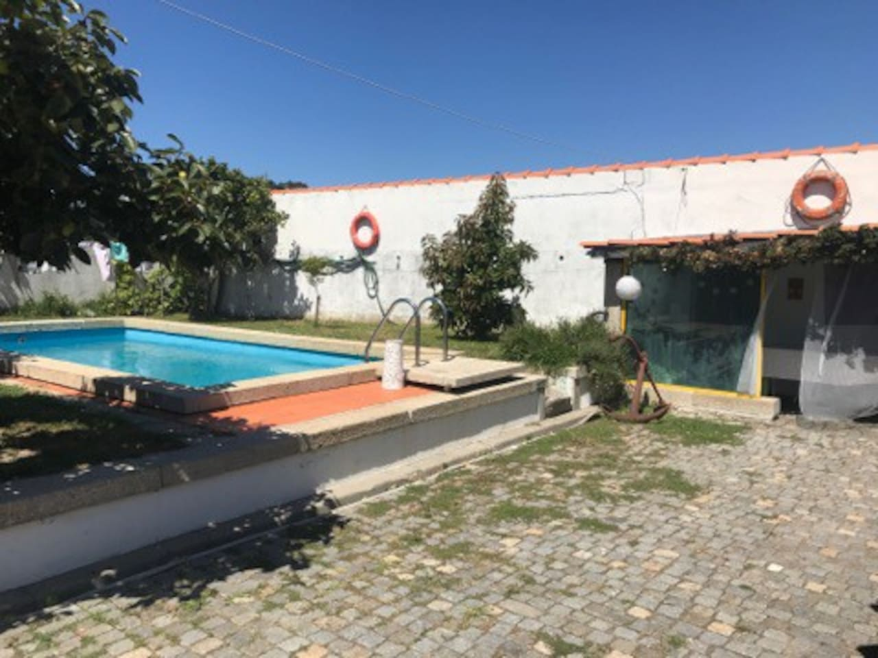 Main Terrace with pool, garden and parking.