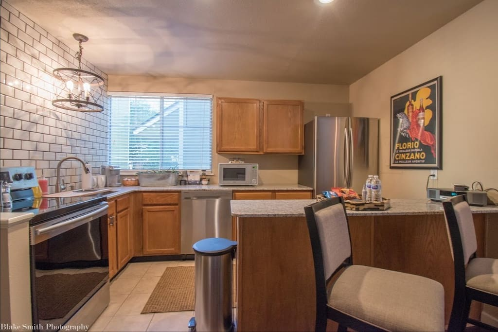 Full sized kitchen with all the essentials! Cook top stove, oven, dishwasher, microwave and refrigerator. Fully stocked with cookware, dishes and utensils.