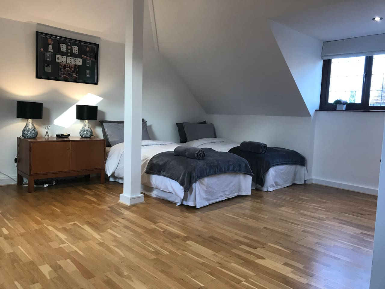 Bedroom with two single beds, space for more if family room required.