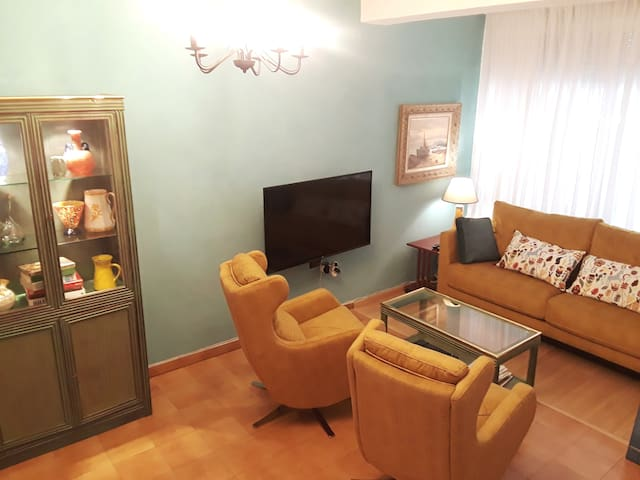 Brand-new livingroom furniture in bright primary colors.  High-definition television with wifi and moviestar cable.