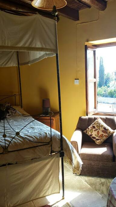 Traditional double bed in studio room no 2, window view