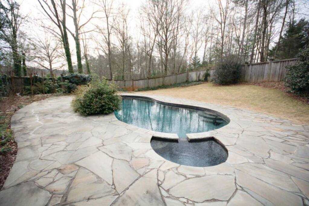 Large heated pool with attached hot tub