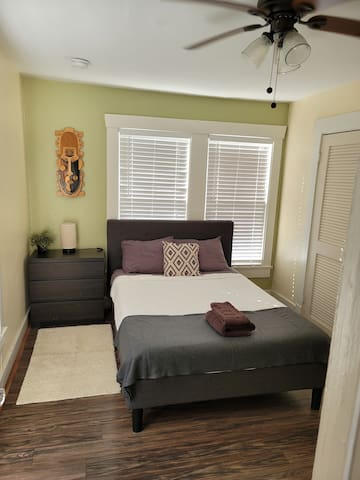 Second room, full size bed,  mirror,  closet.
