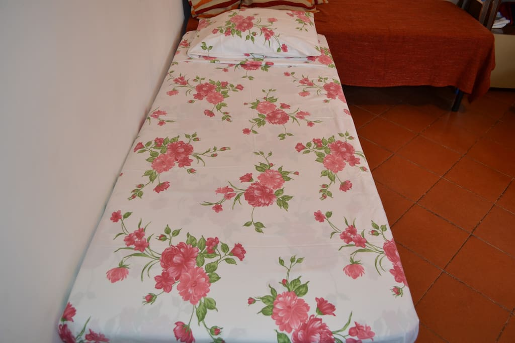 Single Bed. Two single beds can be combined for couples.