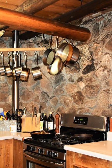 A rounded stone wall in the kitchen.