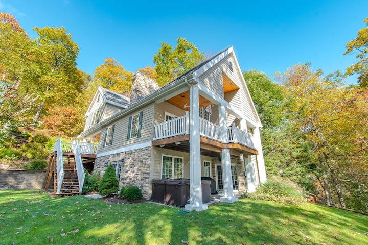 Lakefront Home w/Private Dock, Hot Tub, Game Room, & Carriage House!