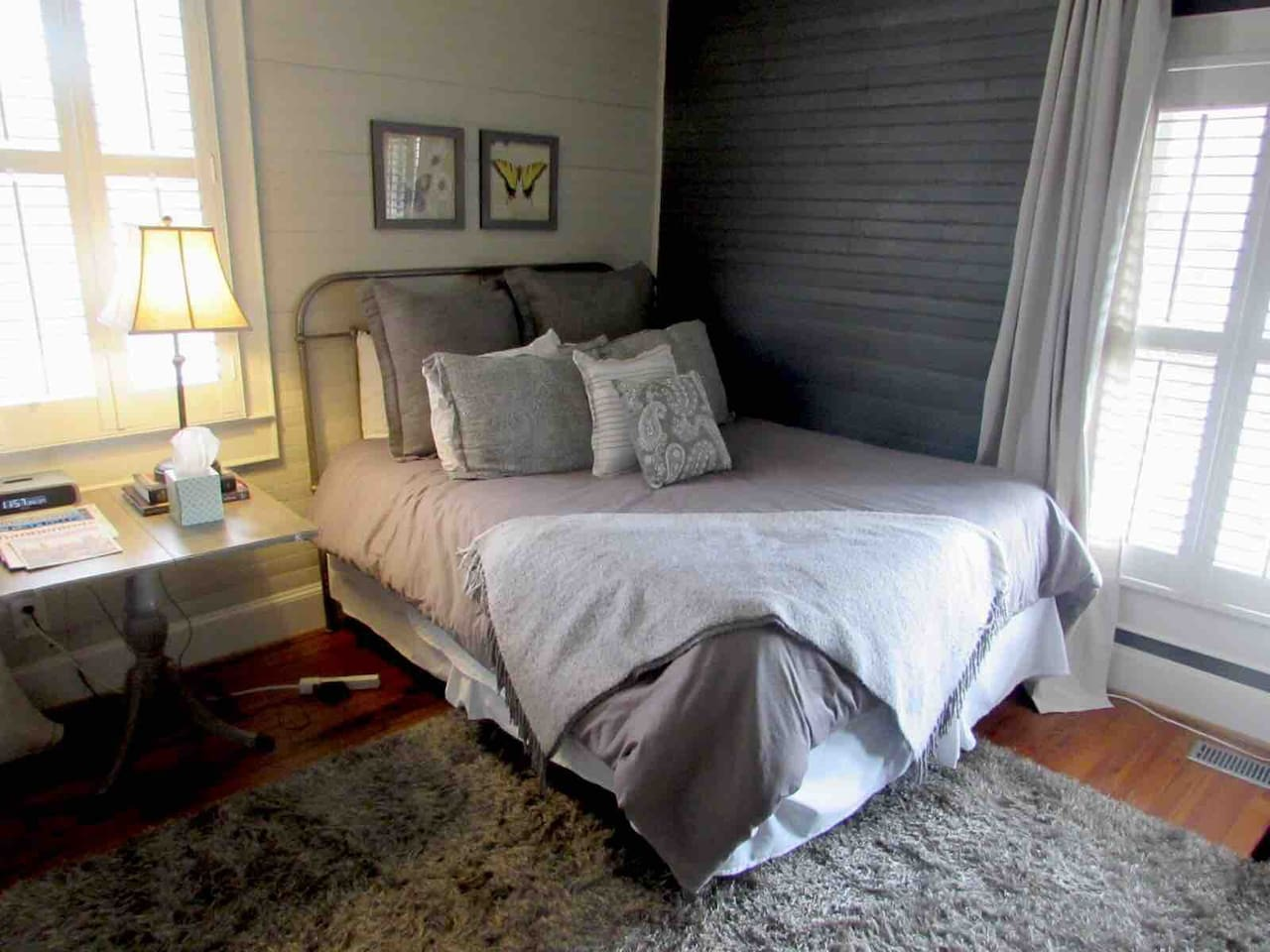 Comfy Queen-size bed with lots of light and plantation shutters.