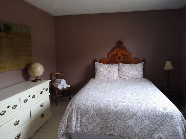New queen bed with King duvet.