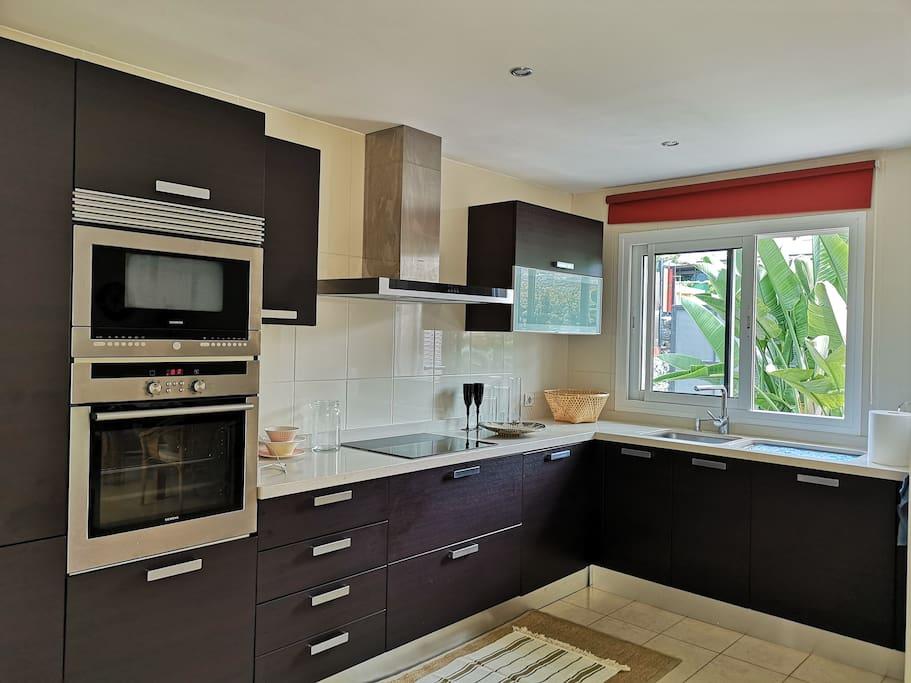 Kitchen view garden. Fully furnished..