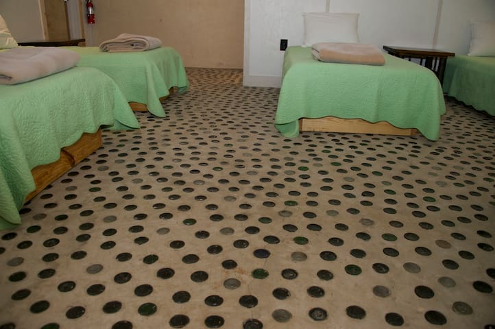 One of the more unique bedroom floors you'll find.  Beer bottle floor.