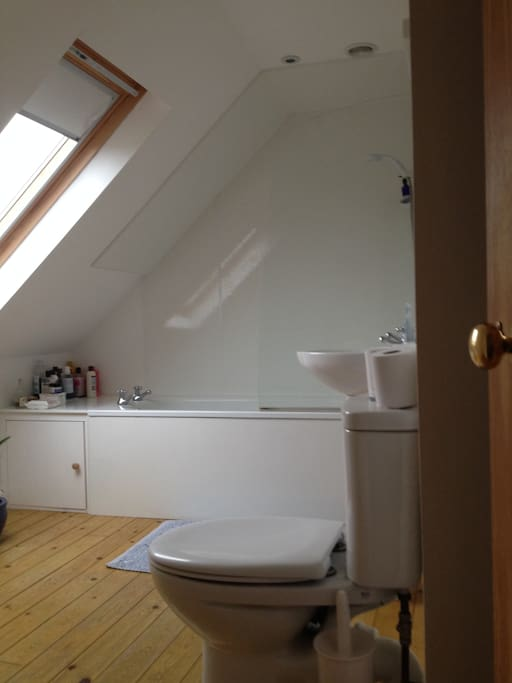 The bathroom has a lovely bath, shower and we supply towels and toiletries