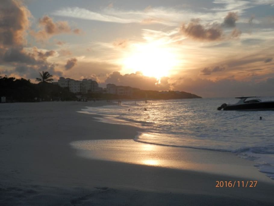Shoal Bay East at sunset with many bars and restaurants to suit your budget.