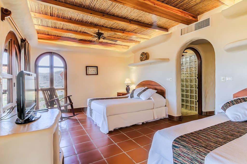 Bedroom #2 - Double Queen Beds ; not pictured is fridge and microwave, patio thru doors to left