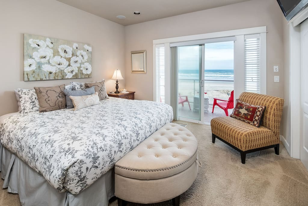 Master bedroom on 2nd floor features king bed, private balcony, en suite bathroom, and flat-screen TV