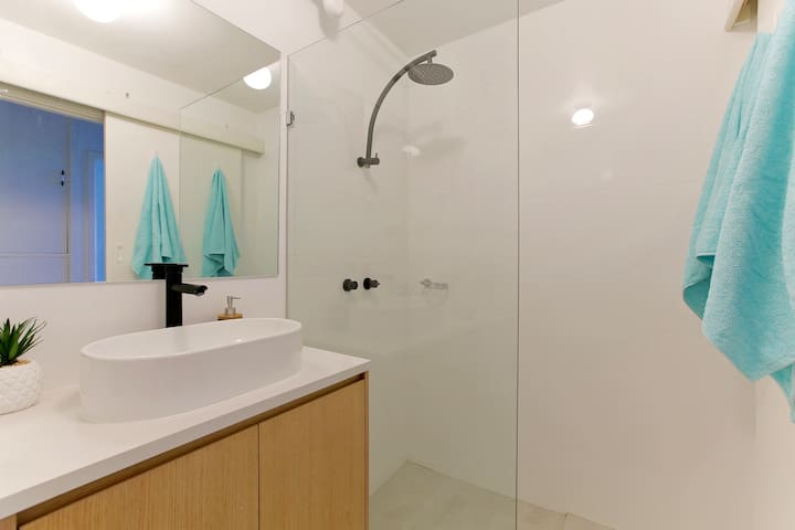 Newly renovated bathroom with modern finishings and large shower head.