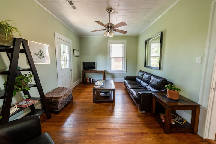 The apartment has twelve foot ceilings and a peaceful feel.