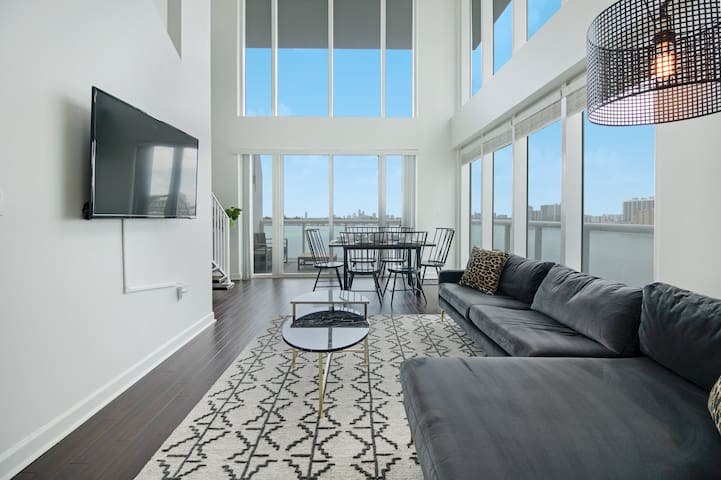 Sextant | 2-Story Waterfront Condo #12 | Heated Pool | 10 mins to Miami Beach