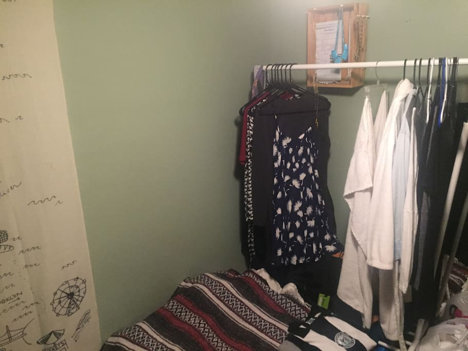 Space to hang clothes, with hangers.