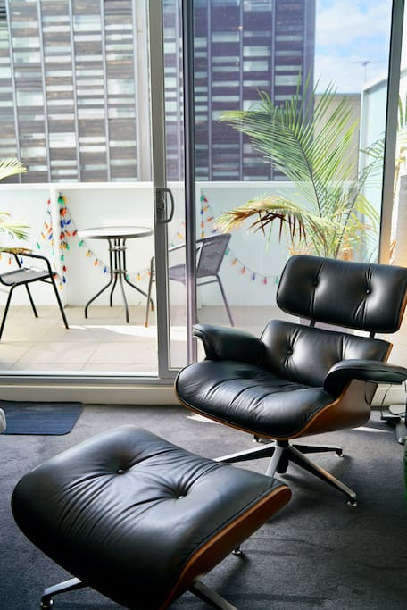 Luxurious eames chair with ottoman.