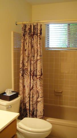 Bath has tub and shower