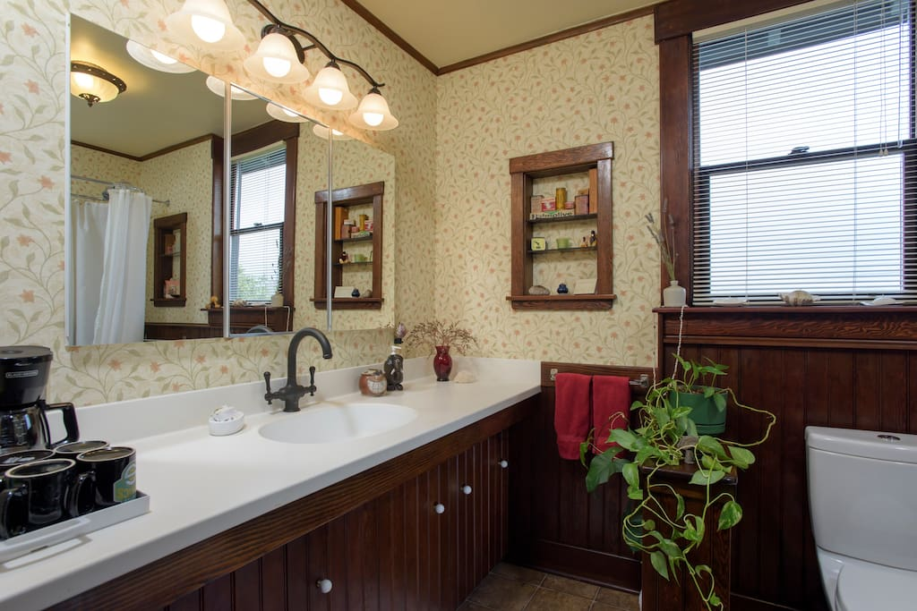 Guest bathroom with large bar sized sink and faucet. Coffee, tea, and accessories provided.