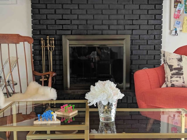 Play games by the cozy fire place