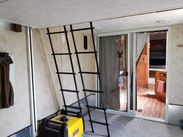 Garage has 2 queen bunk beds; fold down ramp with screen.