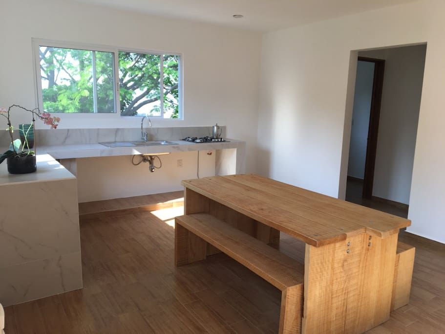 Kitchen and dining area in minimalist style.