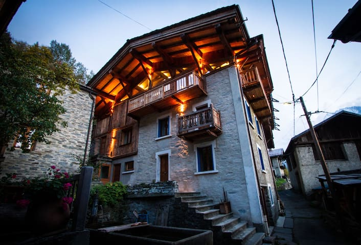 The chalet is expansive, restored using traditional wood and stone