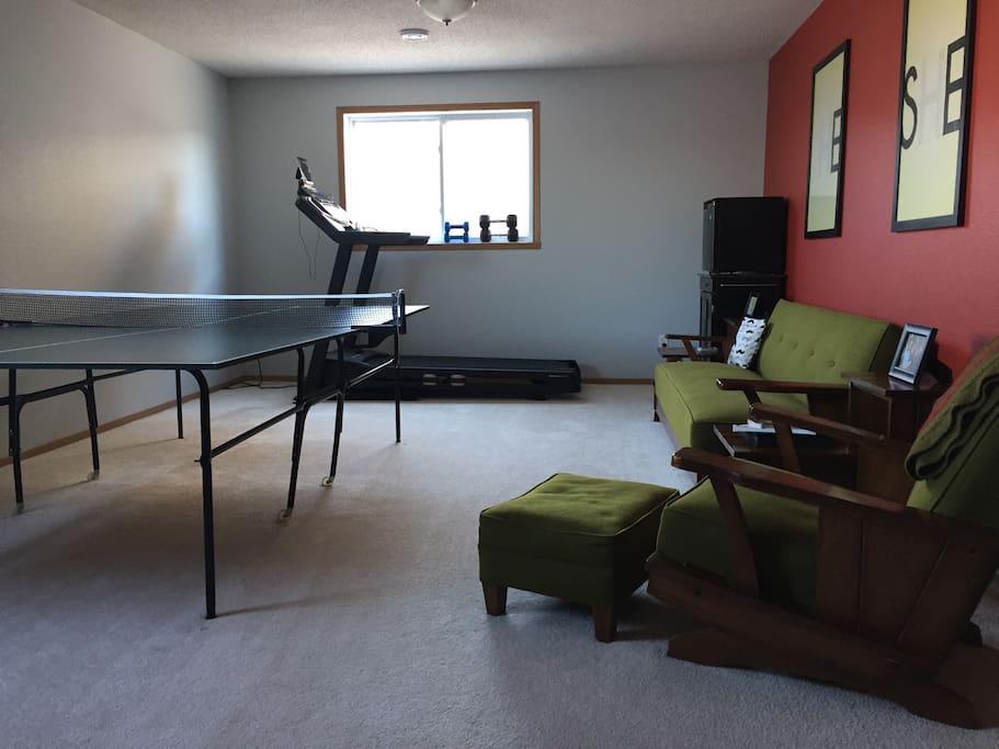 Ping pong table, treadmill, mini fridge, and coffee maker