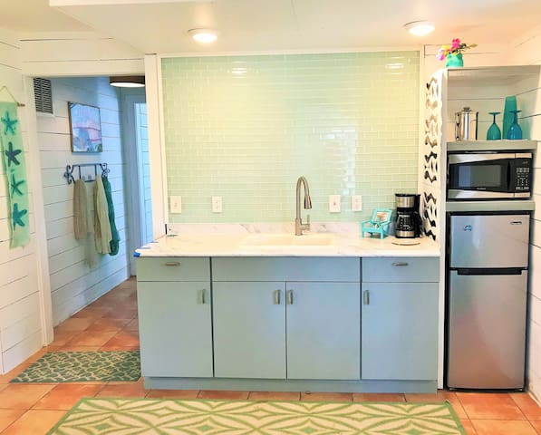 Kitchenette includes fridge/freezer, microwave and coffee maker.  Gas grill available.