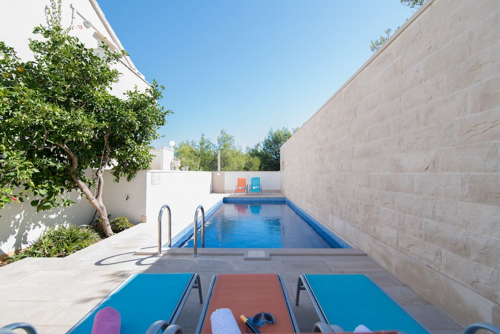 Lovely pool area with sunbeds