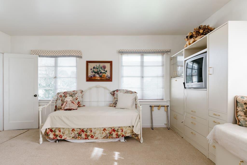A light, cheery bedroom.