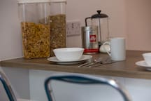 Breakfast bar and easy dining space for two (we provide a simple breakfast with two types of cereal, tea and coffee).