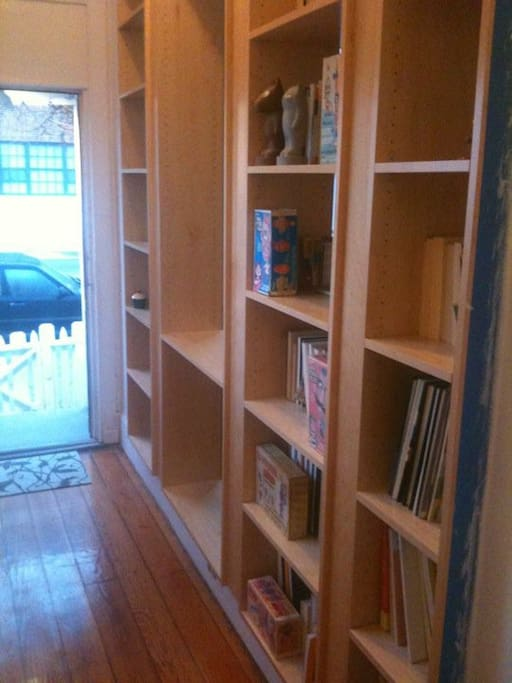 We put in a see-thru bookcase to lets lots of light come through into the living room