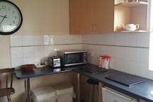 Shared kitchen with microwave and oven