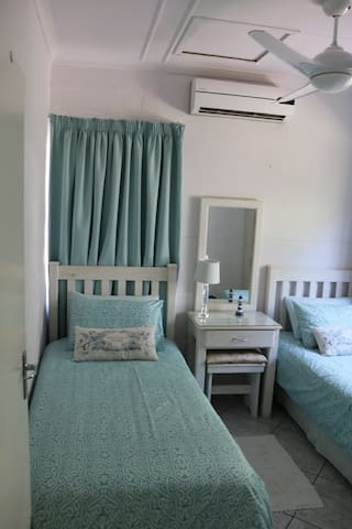 Second bedroom with twin single beds - both bedrooms have aircon