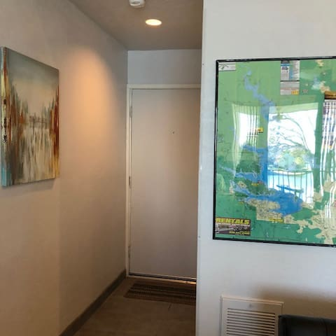 View of entryway with nice map of Lake Conroe