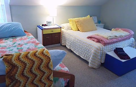 A Master bedroom with Full bed and Day bed