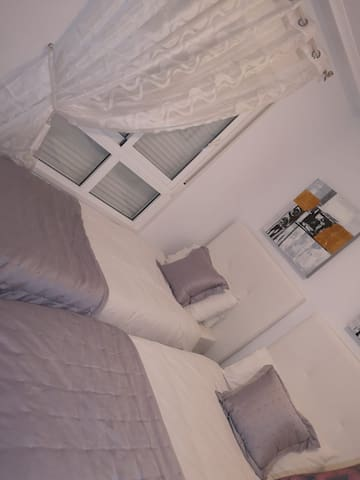 Spacious modern 2nd bedroom  with wardrobes, next to a large family bathroom with bath shower and bidet