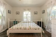 """New queen size memory foam mattress w/ 2"""" down duck feather topper on this bed."""
