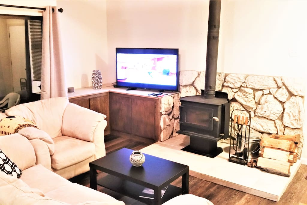Wood burning stove (fireplace) and 55-in TV with DVD and Google Home (stream from your device) in living room